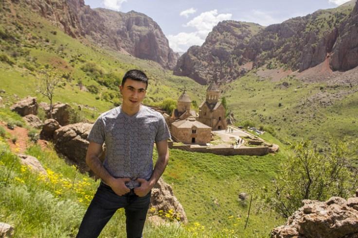 an armenian man next to a church