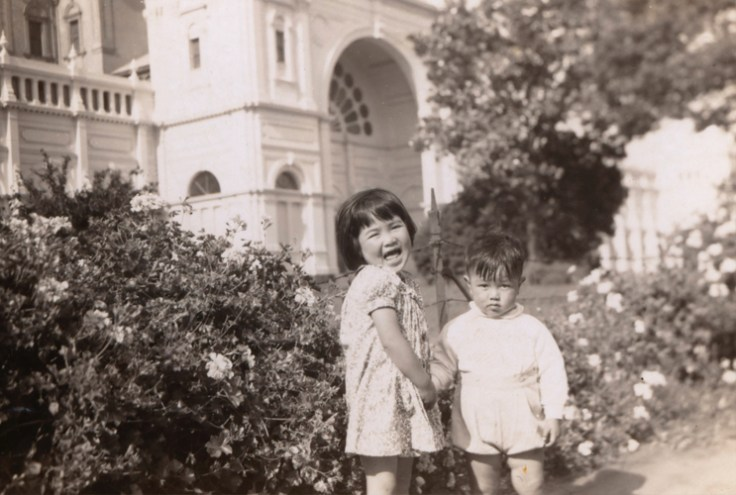 Two chinese australian children outside a building