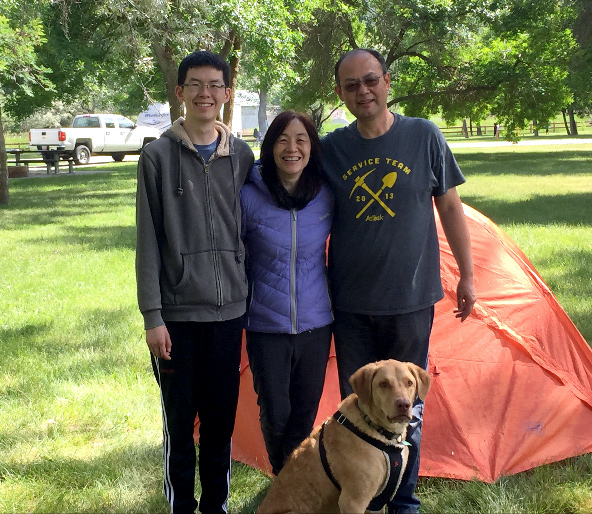 Christine Chiang camping with her husband, son, and dog, Snoopy.