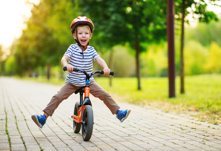 a boy rides a bike, a memory to save in familysearch memory cloud storage