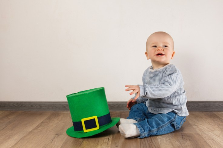 A little boy next to an irish top hat. this boy could have an irish name.