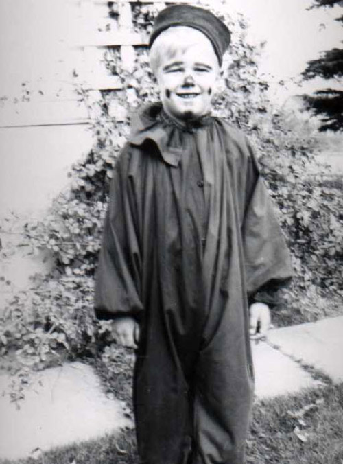 Little boy as a clown for Halloween, old picture.