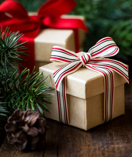 Brown paper Christmas packages tied up with red ribbon.