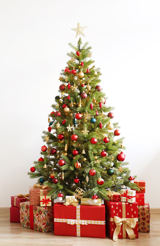 A bright Christmas tree with gifts packaged in red and gold beneath it.