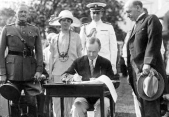 Calvin Cooliage signs Immigration Act of 1924