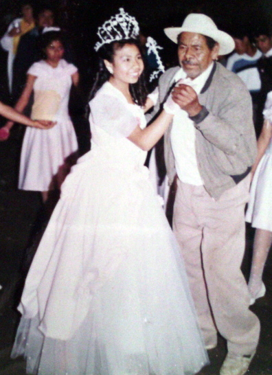 A girl dances with her father on her quinceañera