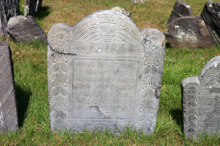 A gravestone with symbols on it