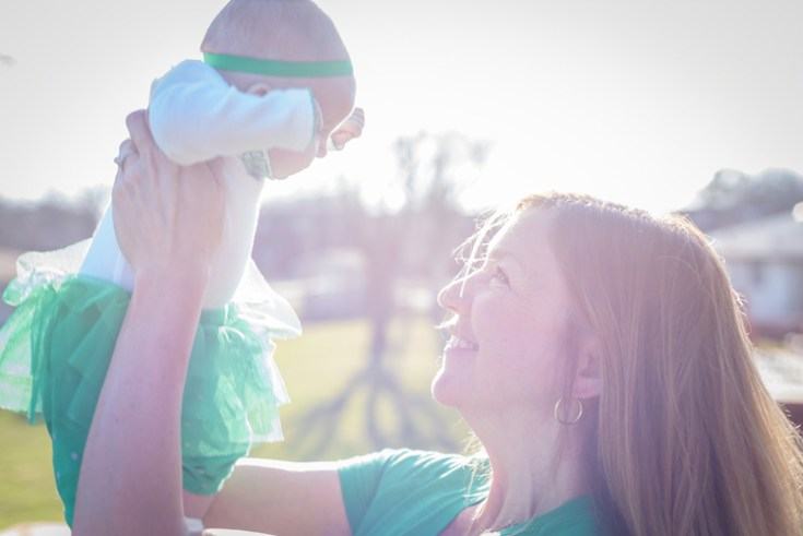 an Irish mother and infant celebrate St Patrick's Day.