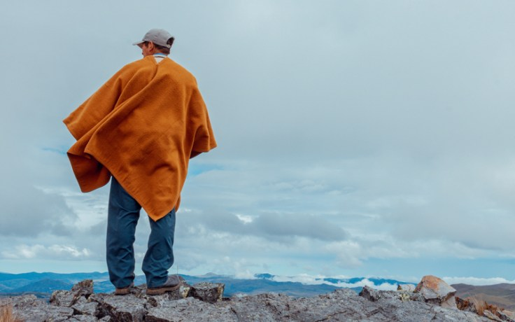A man looking out into a landscape
