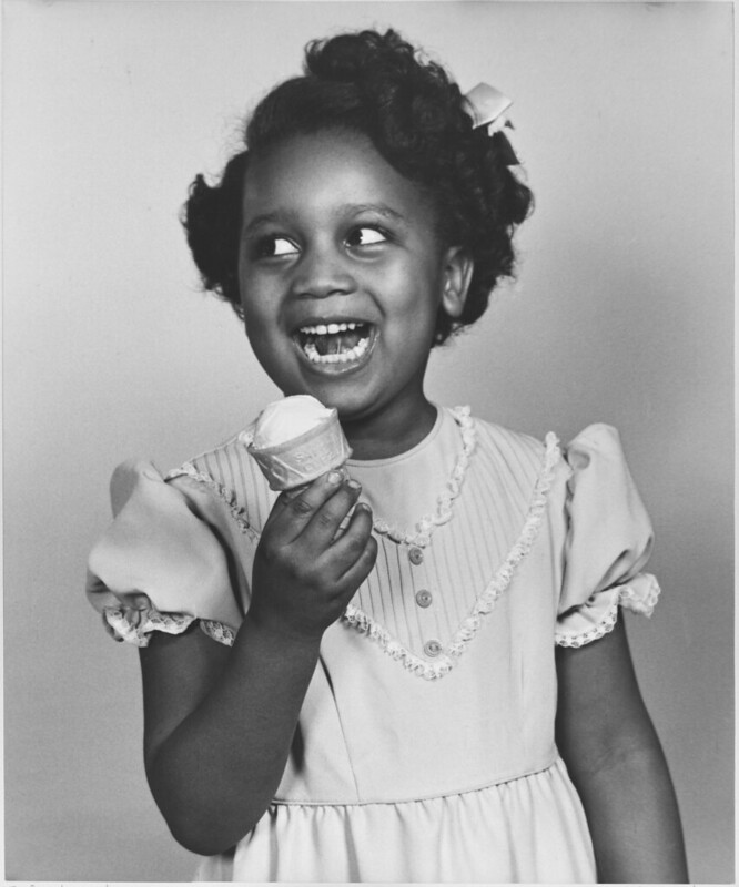 young girl in cute dress with ice cream cone