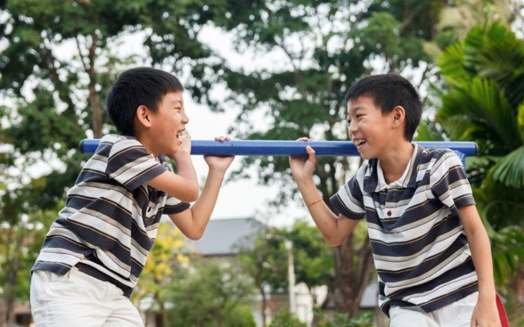 Two doppelganger boys play together