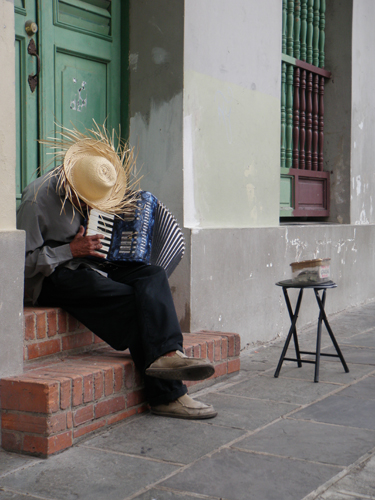 a man in puerto rico playing the accordion