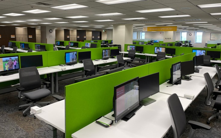 Showing many extra computer stations at remodeled Family History Library.