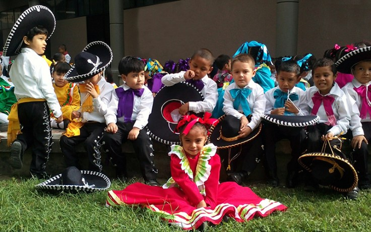 Children dress in tradition Mexican dance outfits