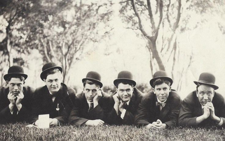 Men from 1910 wear hats, an essential fashion accessory of the time