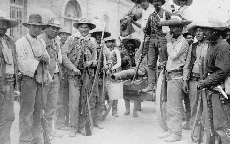 Black and white image from Mexico's colonial era of men holding guns.