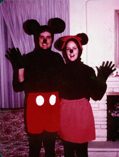 Couple dressed as vintage Mickey and Minnie mouse for Halloween.