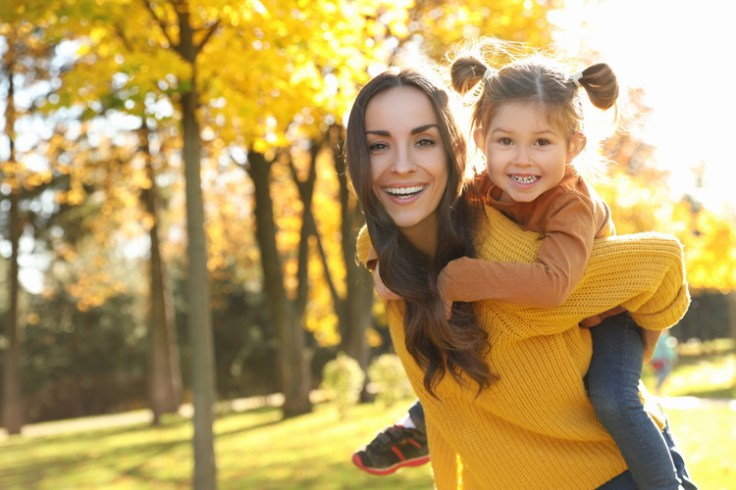 A mother and daughter play at the park