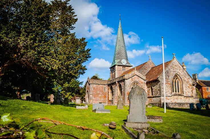 an old church with a graveyard