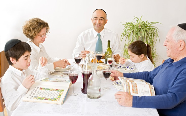 A Jewish family eats a passover dinner.