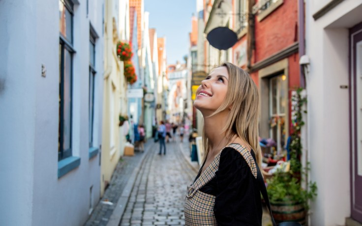 Girl looks up on foreign street