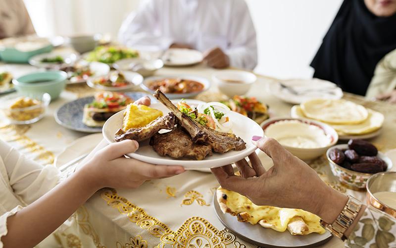 A family shares an Eid al-Fitr feast.