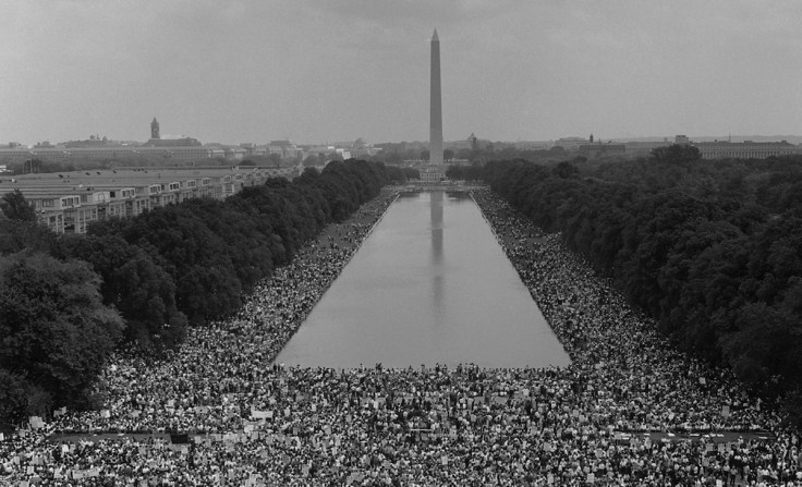 The photographer's focus on faces rather than multitudes emphasizes that the marchers were people with lives and stories of their own.