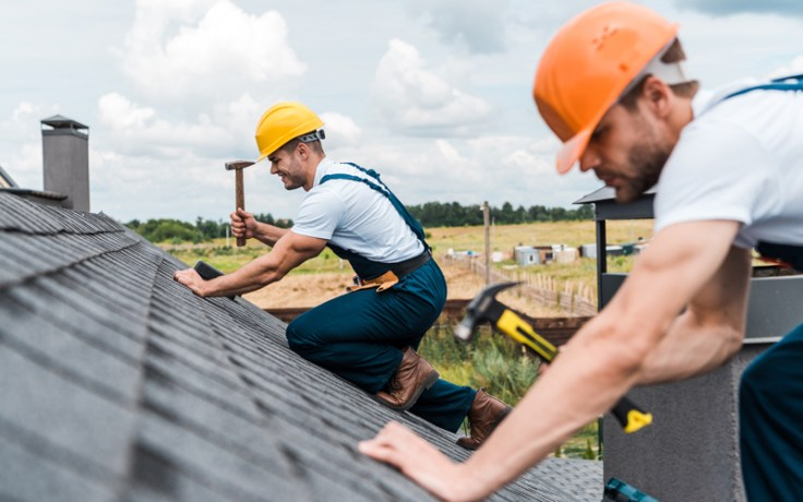 men fixing a roof