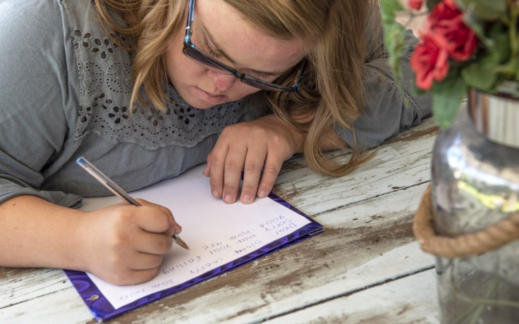 a girl writes a letter