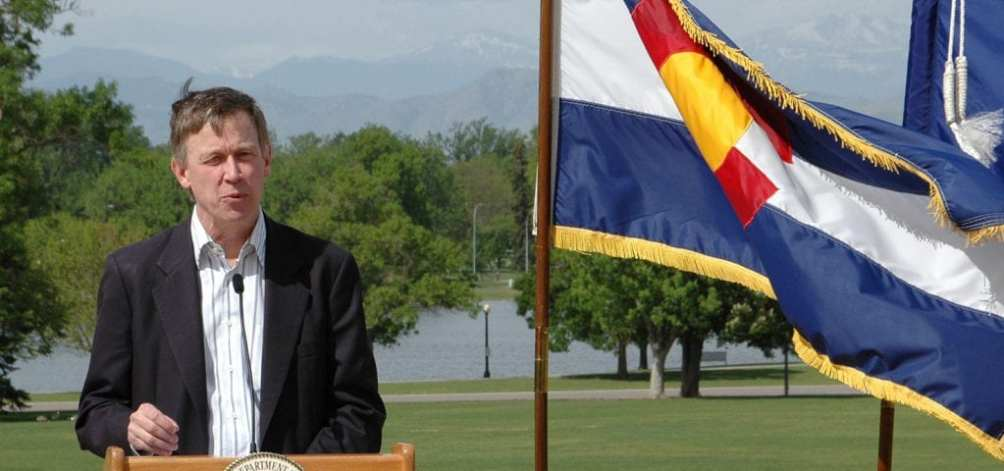 Colorado Gov. John Hickenlooper addresses a crowd at a U.S. Department of Agriculture event.