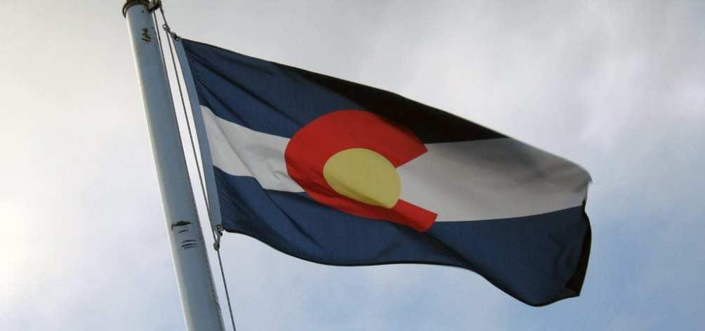 The state flag of Colorado flying in the wind.
