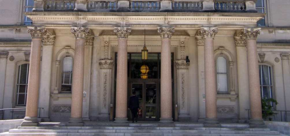 A man enters the front doors of the New Jersey State Capitol Building in Denton, New Jersey.