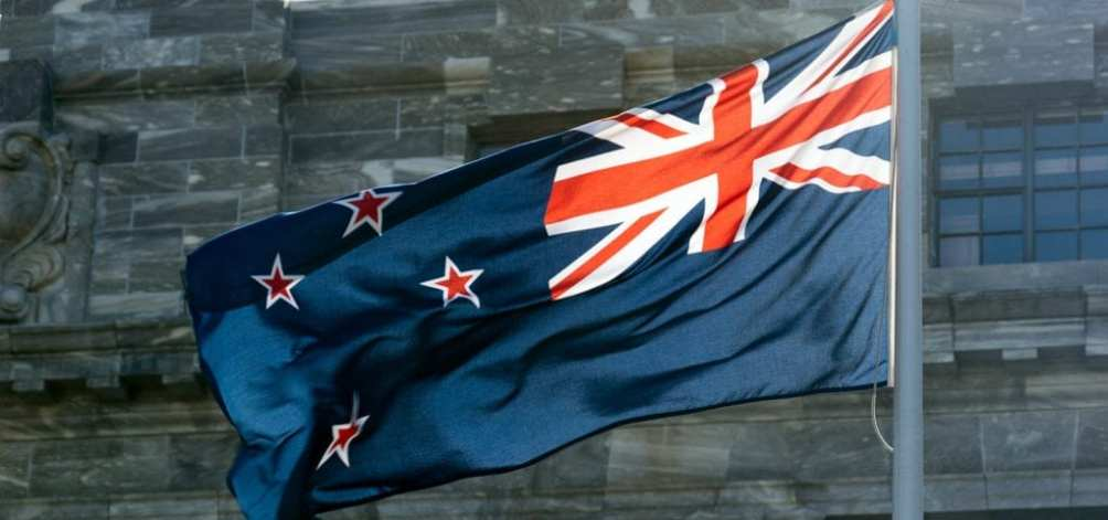The flag of New Zealand flapping in the wind.