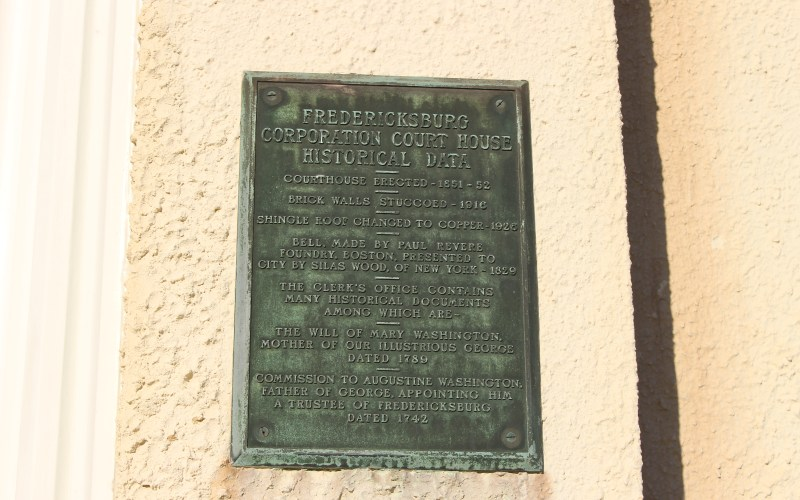 pictured here is cooperation courthouse's building plaque for historical data
