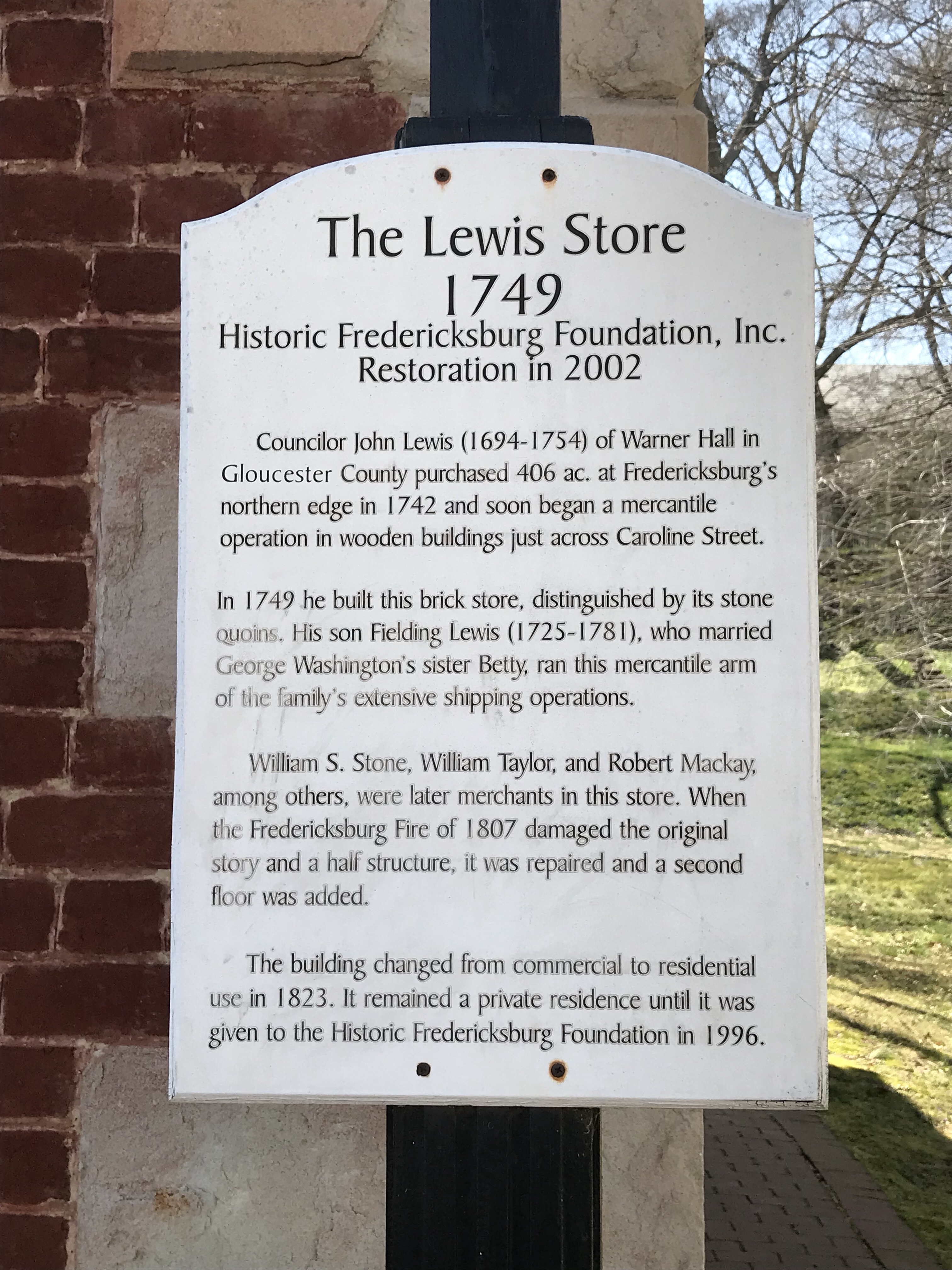 Picture of the sign outside of the Lewis Store