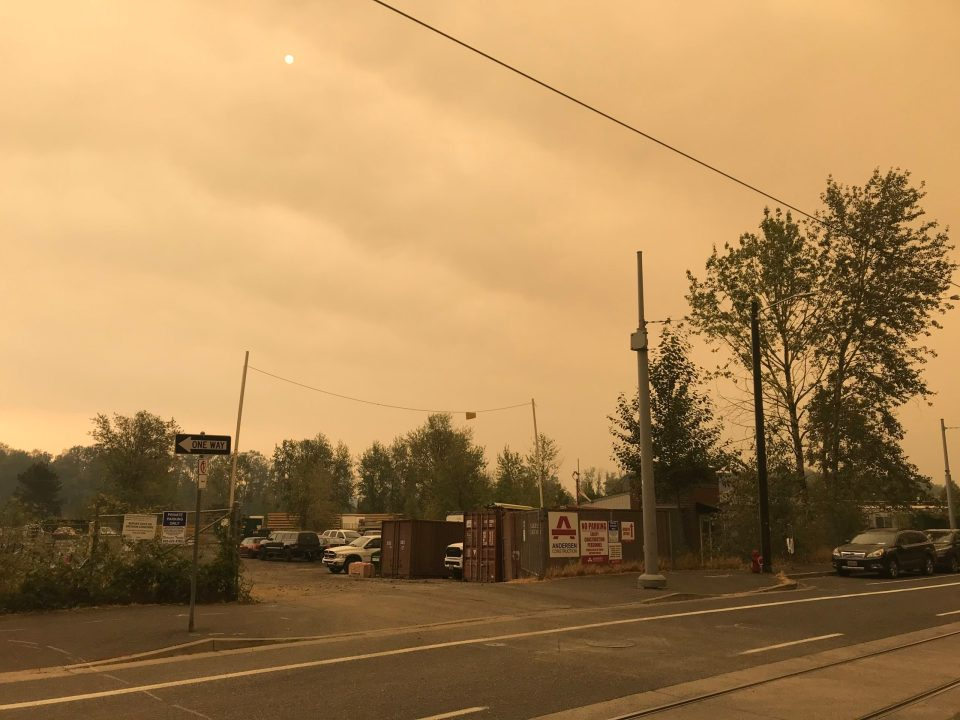 Photo showing smokey skies at the corner of S Bond and Abernathy.