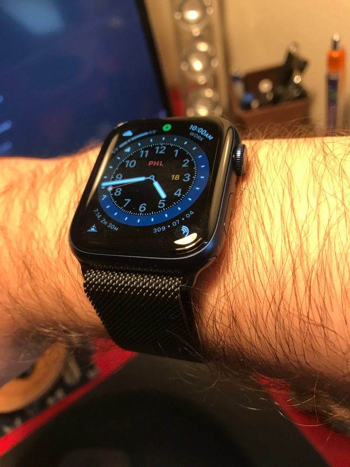 Photo of a Navy Blue Apple Watch Series 6 with black milanese band.