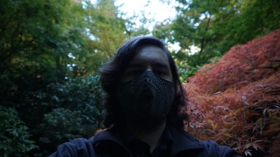 Selfie with a Japanese Maple in the background.