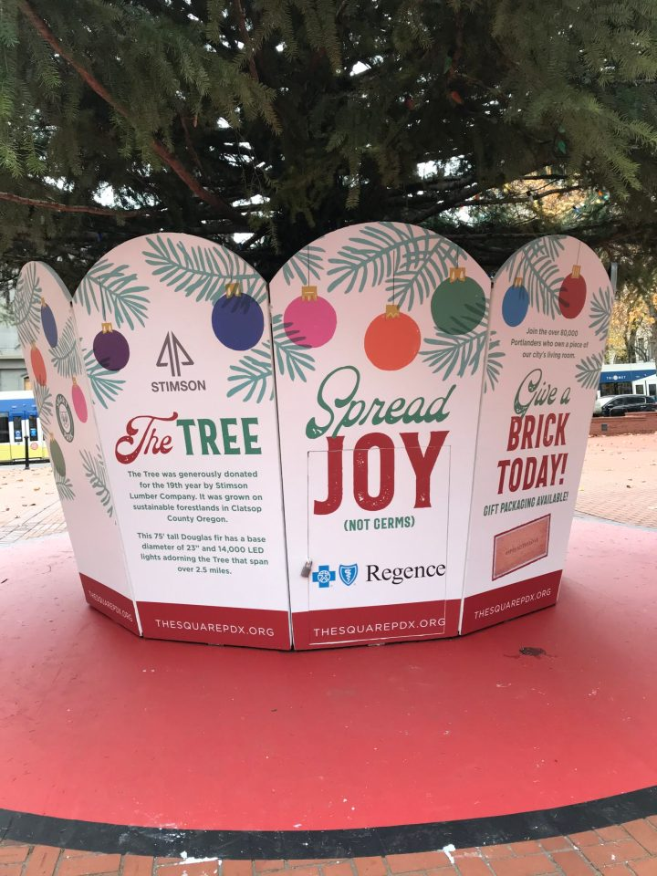 "Photo of a ""Spread joy (not germs)"" sign at Pioneer Square."