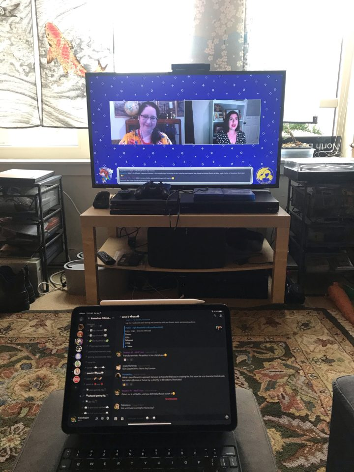 Photo of a DigiKumo livestream on a TV and chat moderation on an iPad Pro.