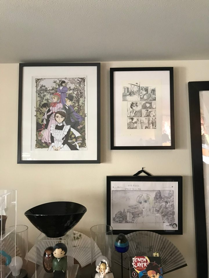 """Photo of art prints from """"Emma"""" hung on a wall."""