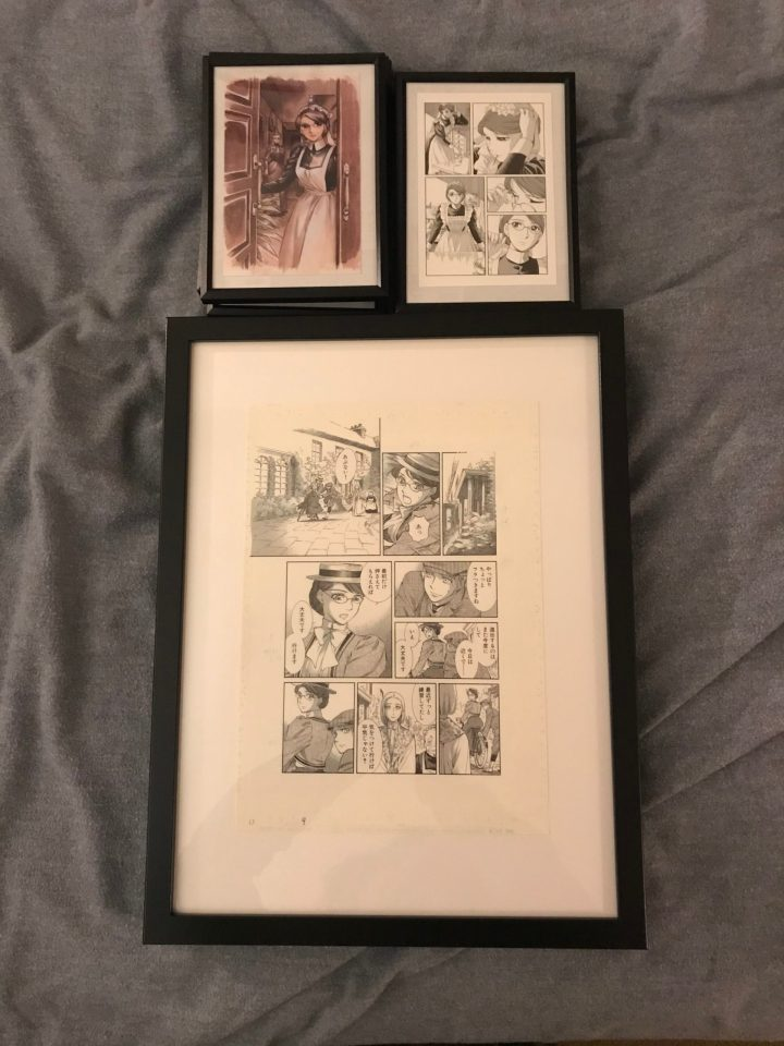 """Photo of framed artwork from the """"Emma"""" Kickstarter waiting to be hung."""