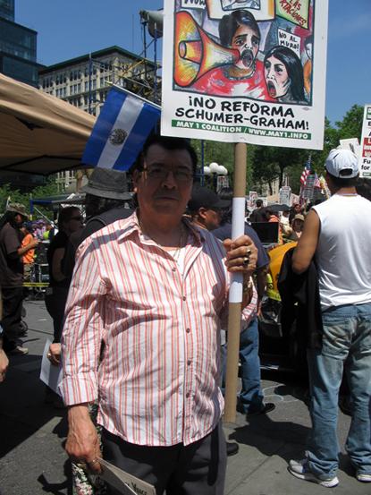 Man Holding Sign Criticizing Immigration Reform Blueprint of Senator Schumer - Photo: Cristina DC Pastor