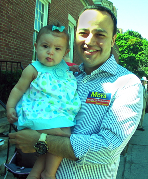 NY Assembly Candidate Francisco Moya, holding his niece - Photo: Cristina DC Pastor