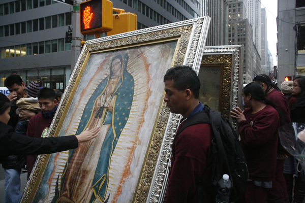 Mexican immigrants carried portraits of the Virgin of Guadalupe across 51st Street - Photo: Sarah Kramer