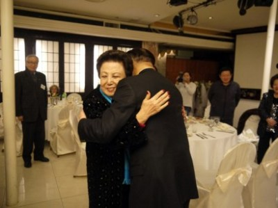 John Liu gets a hug from a longtime supporter at a recent fundraiser