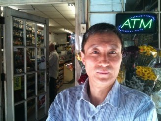 Jung Yang outside Hudson Grocery where he works for his brother. Photo by Miranda Shafer