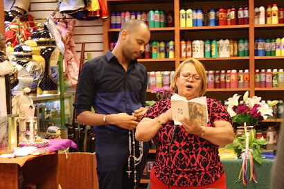 A prayer service at a Washington Heights botanica. Photo: Camila Osorio