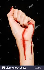 Woman with blood on her hand and wrist Stock Photo - Alamy