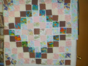 P1010815 laying out baby quilt
